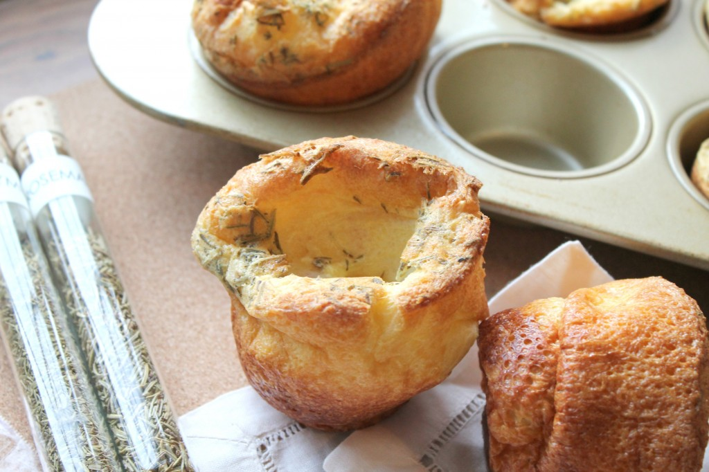 Rosemary Thyme Herb Popovers are a great, last-minute addition to your Christmas table. Plus, they're lighter than dinner rolls, which means you can eat more of them!  Recipe on CookingWithBooks.net