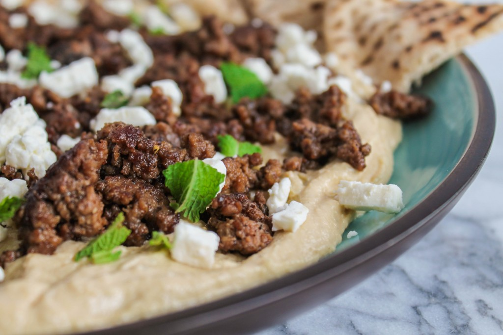 Warm Hummus with Spiced Beef and Feta is an appetizer to love! If you've never eaten warm hummus, your life will change for the better with this recipe. Get it on CookingWithBooks.net