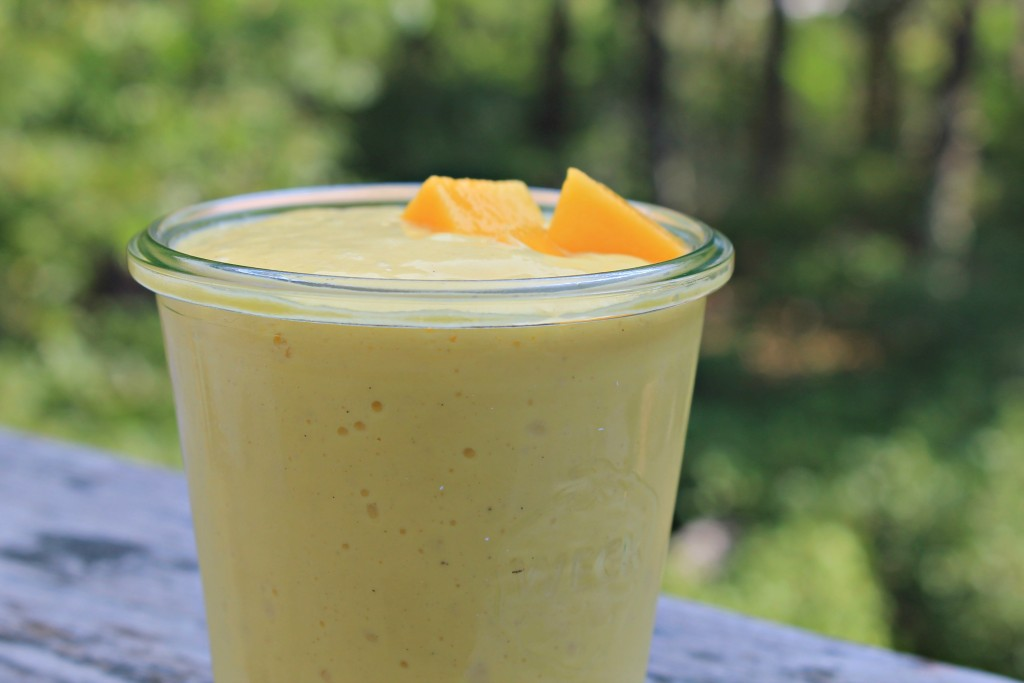 Yogurt mango lassi - it's a refreshing taste of summer in a glass! Packed with delicious coconut milk, yogurt, and a hint of cardamom - yum!