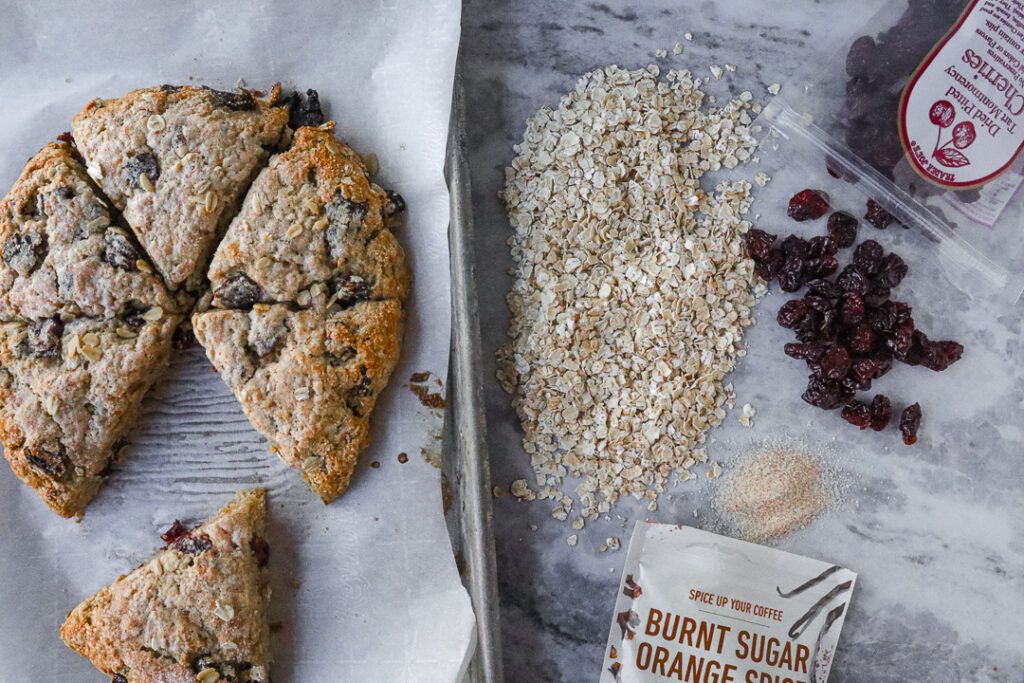 showcase of ingredients for cherry oat scones: dried cherries, oatmeal and orange sugar
