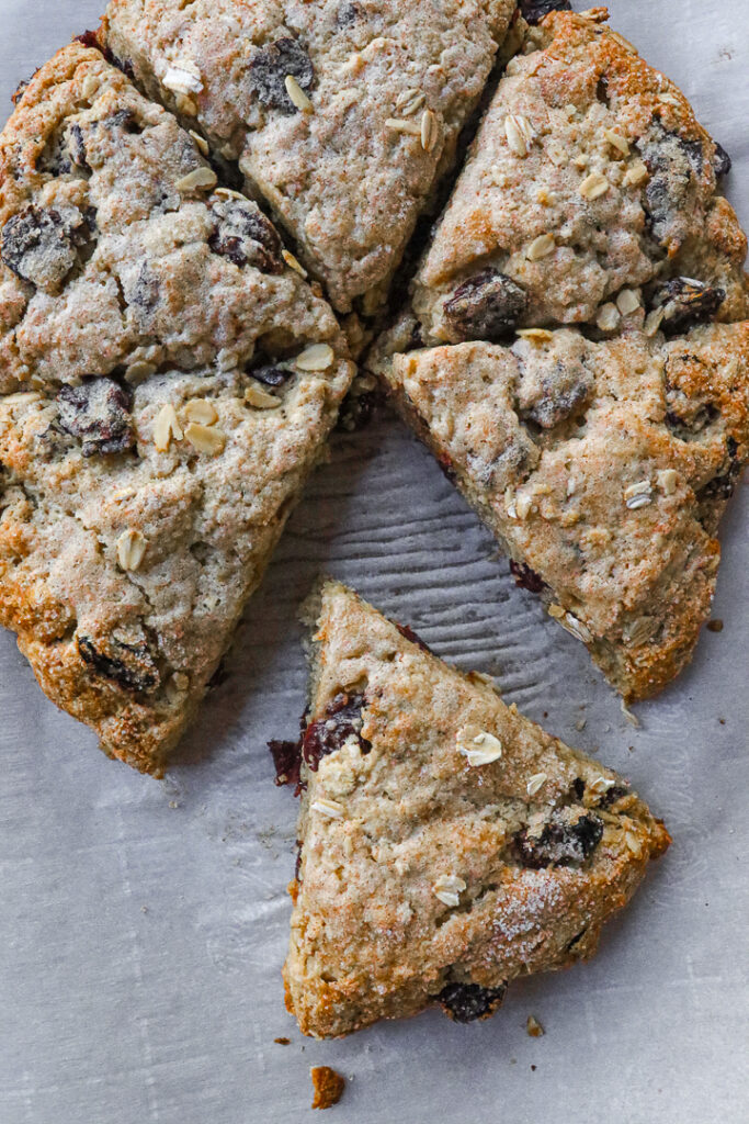 Cherry studded oatmeal scones cut into six slices