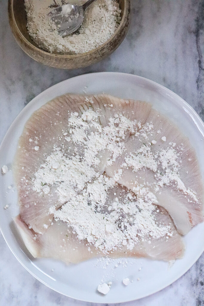 raw skate with flour sprinkled over it